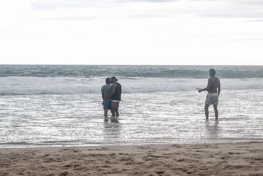 gay couple kissing on Rio de Janeiro gay beach - photos for Queer travel portal